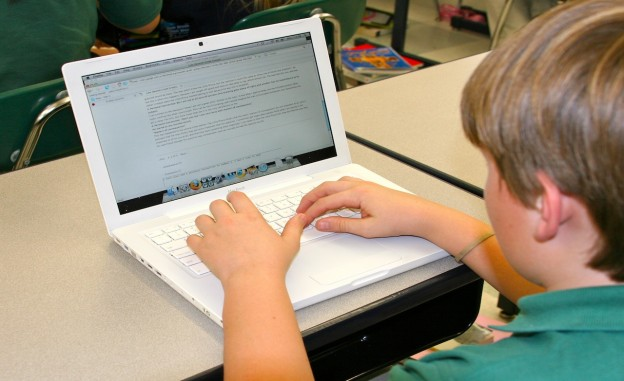 Photo of student on laptop by Karen McMillan on Flickr and used here with Creative Commons license.