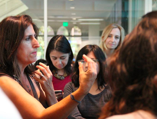 Nonny de la Pena (left) talks to students after her talk at the Women's Hackathon at USC Annenberg