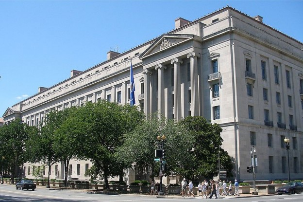 Image of the Justice Department courtesy of User:Coolcaesar and used here under the Creative Commons license.