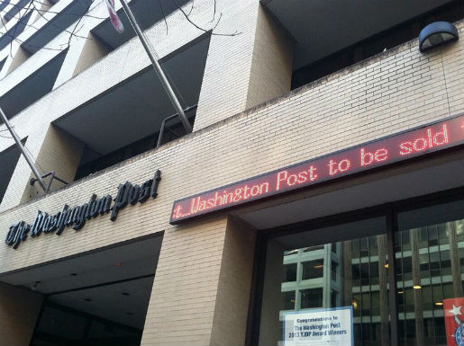 The Washington Post headquarters Aug. 5, featuring ticker announcing its own sale to Amazon founder Jeff Bezos. Photo by Adam Glanzman and used here with a Creative Commons license.
