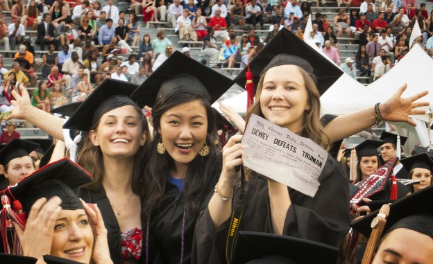 UGA graduates Jeanette Kazmierczak, Gina Yu and Jane Ellyn Hardy celebrate at commencement with one of their favorite newspapers. (Photo/Mark E. Johnson)
