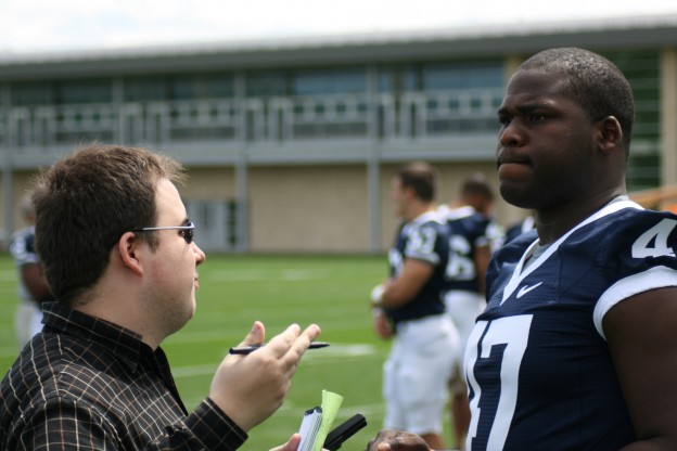 Senior defensive end Josh Gaines chats with football beat writer Derek Levarse about the upcoming season. Gaines was also named a team captain, along with Sean Lee, A.Q. Shipley and Anthony Scirotto. Photo courtesy of Penn State and used here with Creative Commons license.