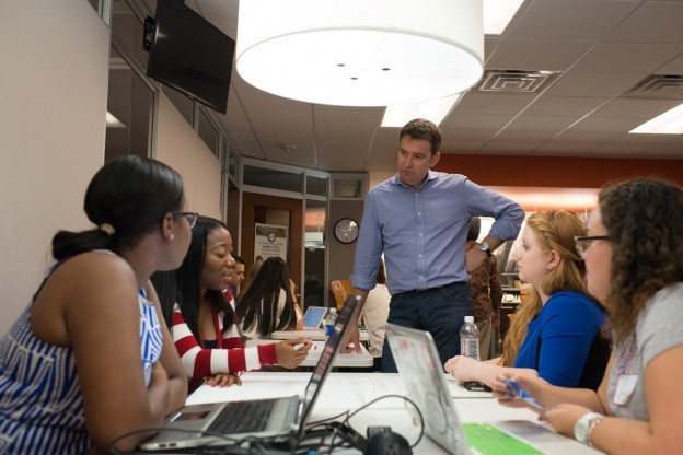 Storyful's Mark Little speaks with journalism students during his visit  University of Florida on Sept. 18. Photo by Steve Johnson.