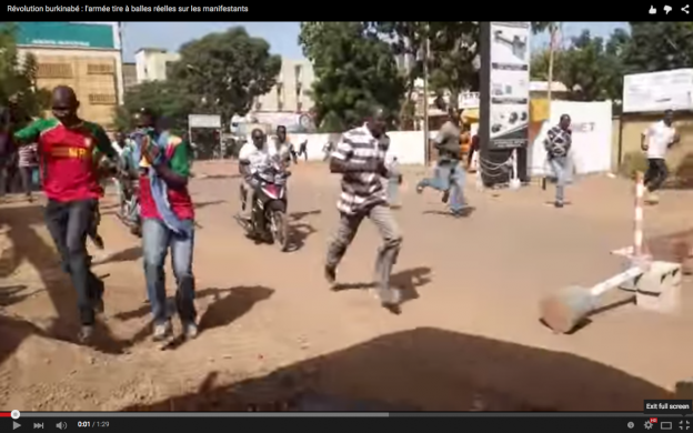 Burundian democracy activists flee a protest.