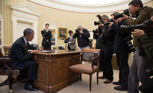 """Photojournalists photograph President Barack Obama"" by Pete Souza - White House. Licensed under Public Domain via Wikimedia Commons."