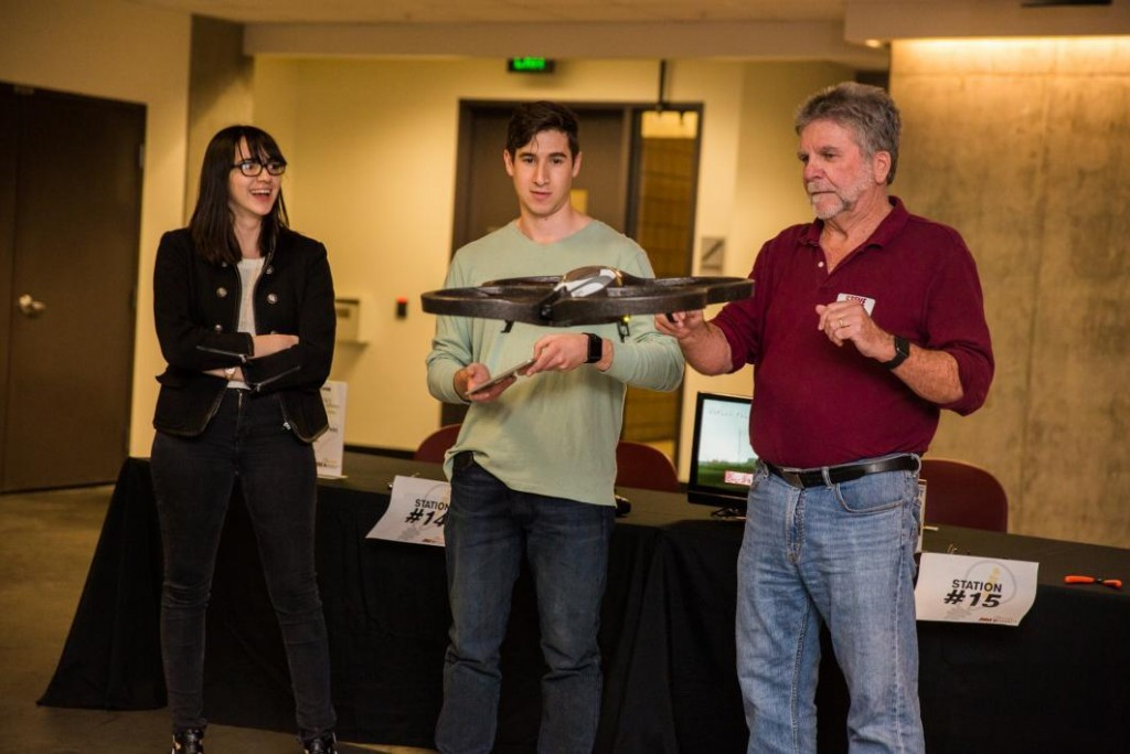 Global studies senior Jawad Shahbandar tries out a drone while his friend Carolina Marquez, a journalism senior, and professor Steve Doig watch during Innovation Day. Photo by Deanna Dent/ASU Now.