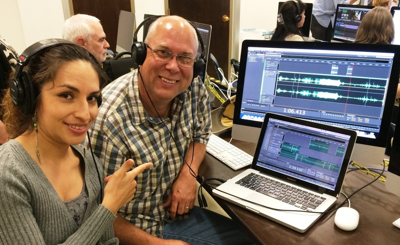Fronteras Desk senior field correspondent Monica Ortiz Uribe trains UCF journalism instructor Rick Brunson in the art of audio editing at the Dow Jones Multimedia Training Academy in El Paso, Texas. Photo courtesy of Rick Brunson.