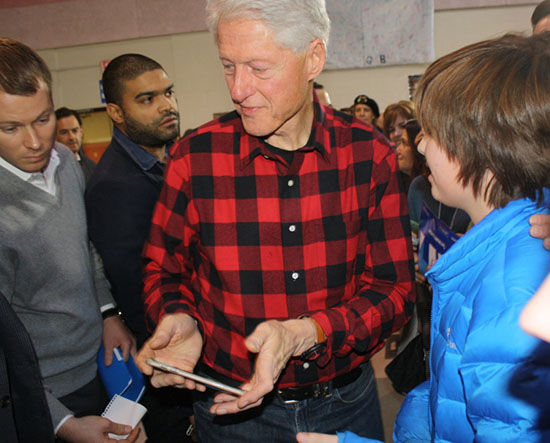 Former president Bill Clinton greets supporters at a Hillary for America rally at Milford Middle School in New Hampshire, while presidential candidate Hillary Clinton helps with the water crisis in Flint, Michigan. Photo by Sharon Lee , AU