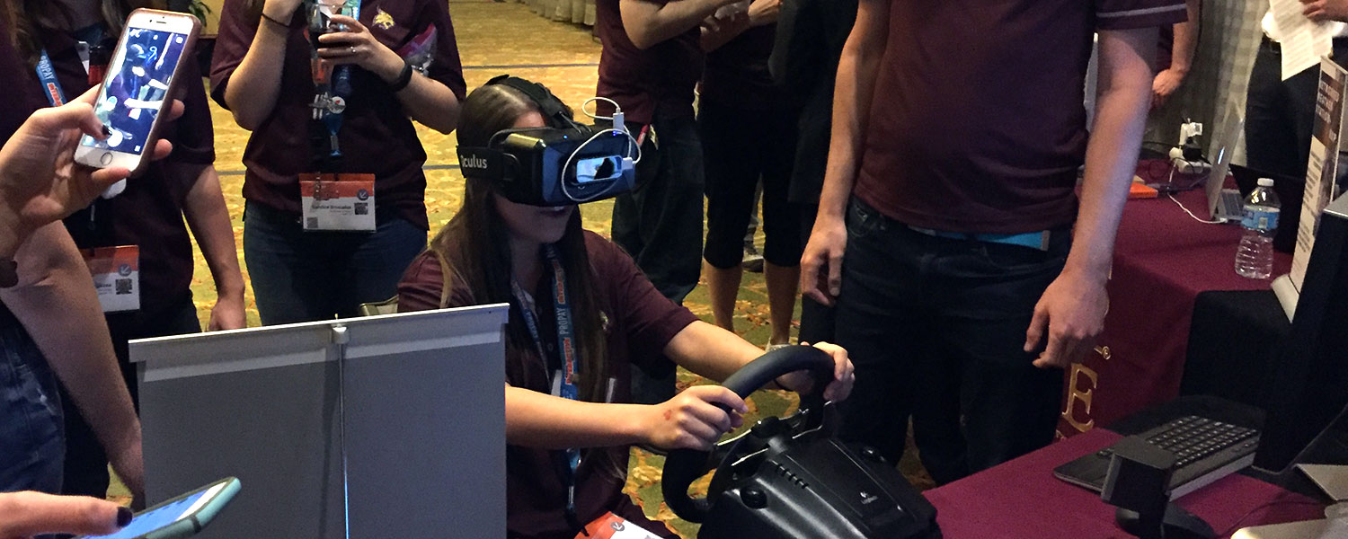 Texas State graduate student Sara Shields experiments with virtual reality at the TXST Innovation Lab and Reception.
