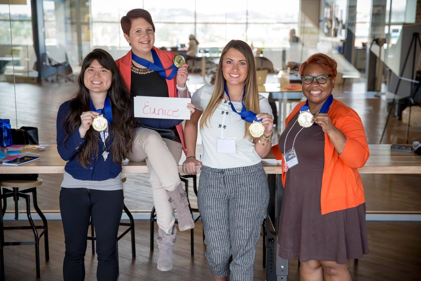 "Members of the ""clothespin"" team posing with their medals after winning first in the WVU Hack the Gender Gap Makeathon."