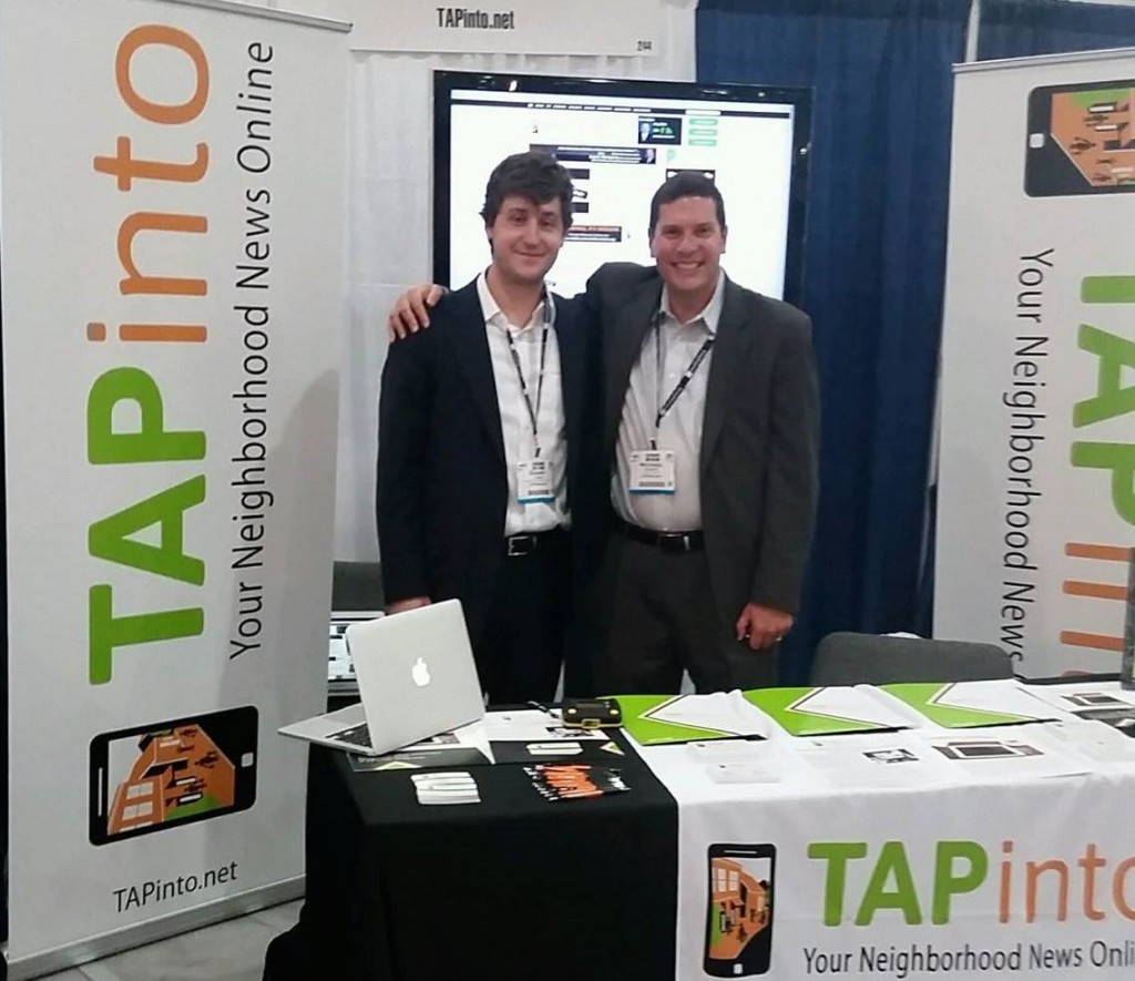 Shapiro, right, with an employee at  a convention event. Photo courtesy of Mike Shapiro.