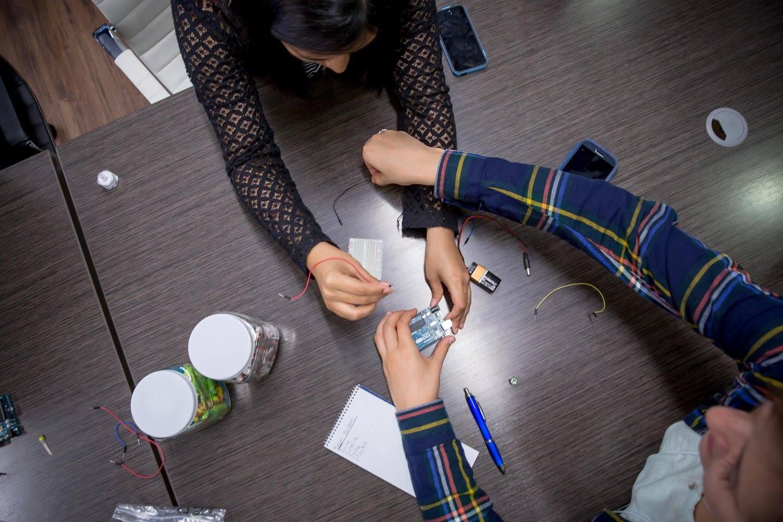 Women learn the interworkings of an arduino. Photo Credit: David Smith.