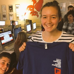 Nova Meurice getting her Flipboard t-shirt and certificate after being selected for publication.