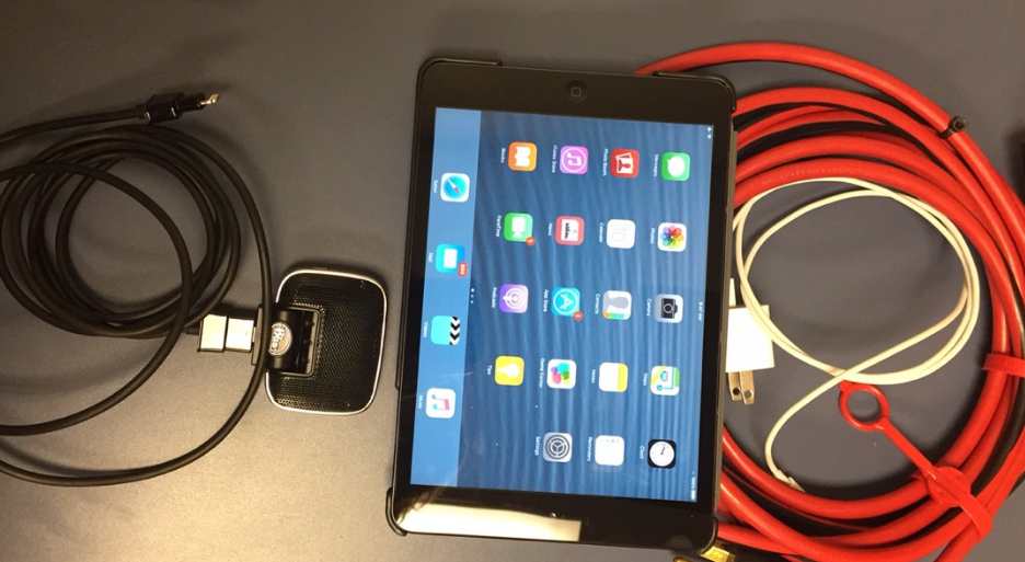 The set up needed to broadcast live is relatively simple and affordable. Pictured are a Mikey microphone, an iPad mini and power cords.