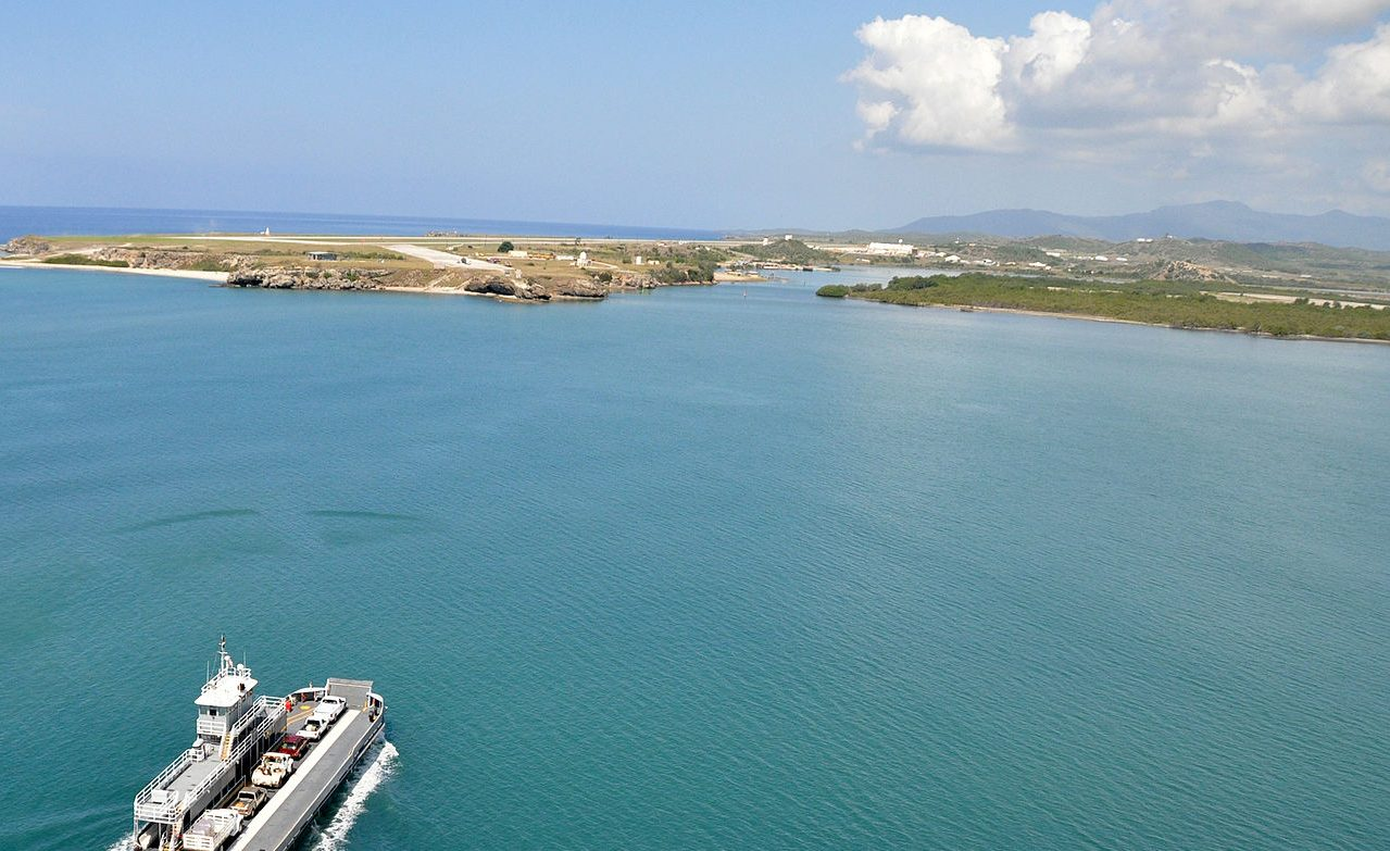 US_Navy_100506-N-8241M-286_An_aerial_view_of_a_yard_boat_ferry_crossing_the_harbor_at_Naval_Station_Guantanamo_Bay,_Cuba