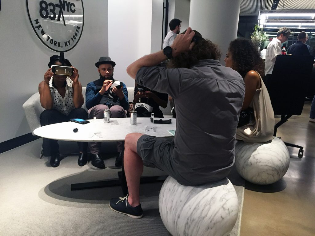 Participants at The Future of Virtual Reality event in New York City try on VR headsets. Photo by Bianca Fortis.