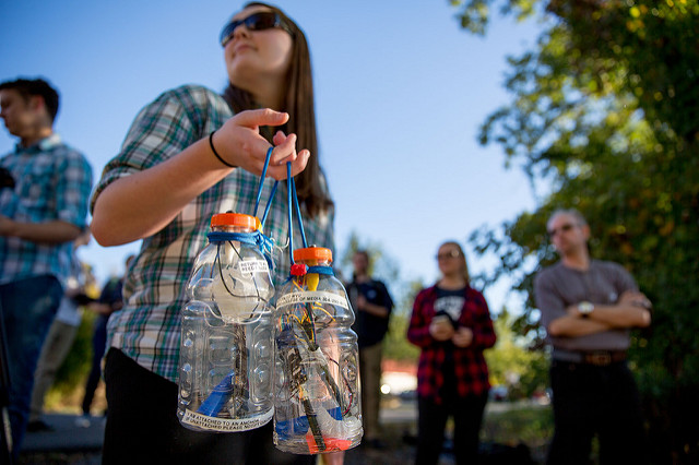 """West Virginia University Reed College of Media student Jillian Clemente was in the """"Experimental Journalism"""" class and helped design and assemble the housing (a Gatorade bottle) for the DIY sensors used in the WVU Stream Lab project. Photo by David Smith."""