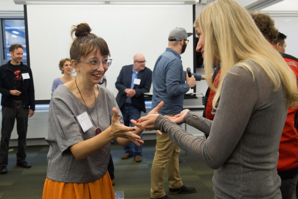 """Participants at Collab/Space do the """"Celebrity Head Toss"""" improv exercise"""