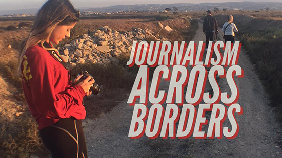 USC journalism student and Dímelo editor Barbara Estrada checks her camera while on location with a team of reporters from Fusion near the California-Mexico border. USC students worked with Fusion to cover stories near the border in October.