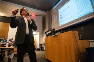 "John Keefe, senior editor for data news and journalism technology at WYNC, New York Public Radio, presents during the ""Coding for the Future"" panel at the West Virginia University P.I. Reed School of Journalism."
