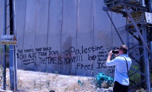 Christopher Essner, a 2013 graduate of Rutgers University, photographs the separation wall the divides East Jerusalem from the rest of the city.