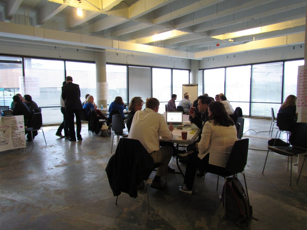 Groups break-out into small groups to help startups work through challenges.