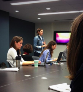 Anderson (standing) and ICFJ staff, courtesy of Irene Moskowitz
