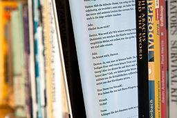 Ebook between paper books by Wikipedia Commons user Maximilian Schönherr.