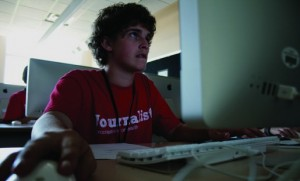 A student works on a website for his school's newspaper. The student was attending a five day journalism workshop at Ball State University in Muncie, Ind. Photo by MoMoNWI on Flickr and used here with Creative Commons license.