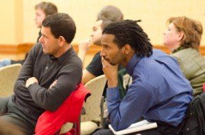 From left, Greg DiPasquale and Alexander Harshaw listen to a speech at the Scripps Innovaion Challenge kickoff event in Baker Center on Tuesday, Feb. 11, 2014. / Photos by Yi-Ke Peng