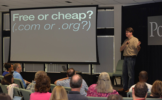 photo of Mark Johnson presenting with screen