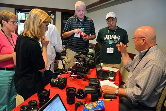 photo of educators checking out cameras at Teachapalooza
