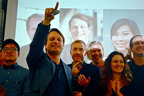 Corey Ford, with hand raised, appears with members of the second Matter class, at their Demo Day in San Francisco.