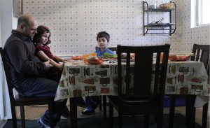 A family sits for dinner in a neighborhood just outside of Atlanta. (Photo/Lyric Lewin)
