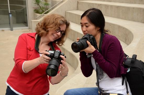 Yvonne Wu and Marina Hendricks practice using DSLR cameras at the University of Missouri - Columbia.