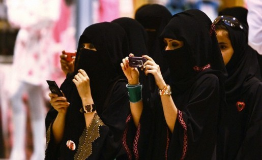Veiled Saudi women take photos of their children during a ceremony to celebrate Saudi Arabia's Independence Day in Riyadh, Saudi Arabia, September 23, 2009. Photo by Flickr user Tribes of the World and reused here with Creative Commons license.
