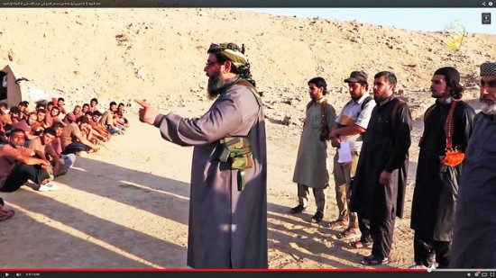 A sheikh armed with a knife and pistol teaches with outstretched index recruits in an Islamic State boot camp. Screenshot photo by Karl-Ludwig Poggemann and reused here with Creative Commons license.