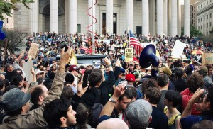 Cameras aloft. A scene from the 2011 Occupy Wall Street protests. Photo by Timothy Karr.