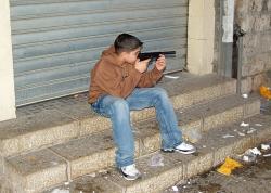 i-2ce579b0f365e48fce8e52a75af0a699-250-Palestinian_boy_with_toy_guy_in_Nazareth_by_David_Shankbone-thumb-250x178-2945.jpg