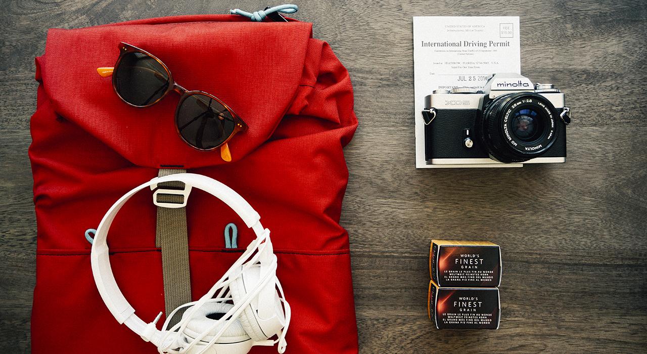 backpack travel journalism camera